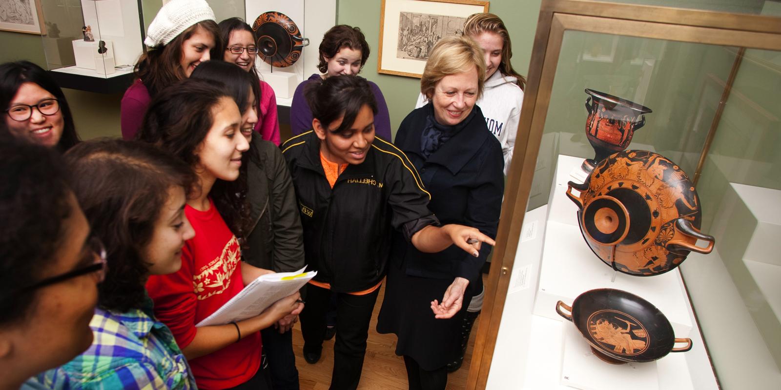 Professor Bettina Bergmann and art history students examine Greek vases
