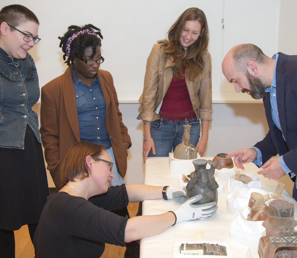 Five College Assistant Professor of Anthropology Elizabeth Klarich and students examine ancient Peruvian vessels