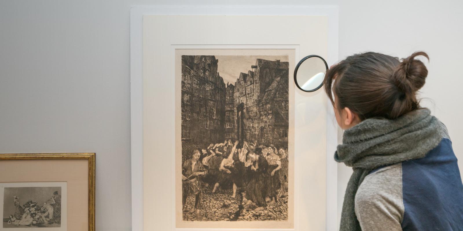 Student examining a print, Spring 2018
