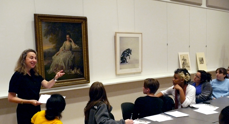 Professor Elizabeth Young and English students examining art in the Carson Teaching Classroom