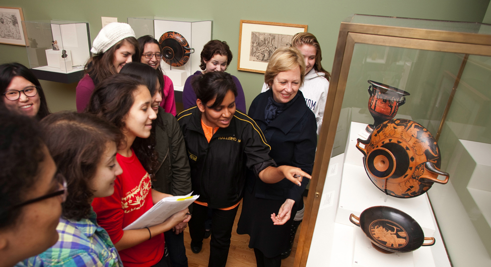 Professor Bettina Bergmann and art history students tour the exhibition Wine and Spirits: Rituals, Remedies, and Revelry