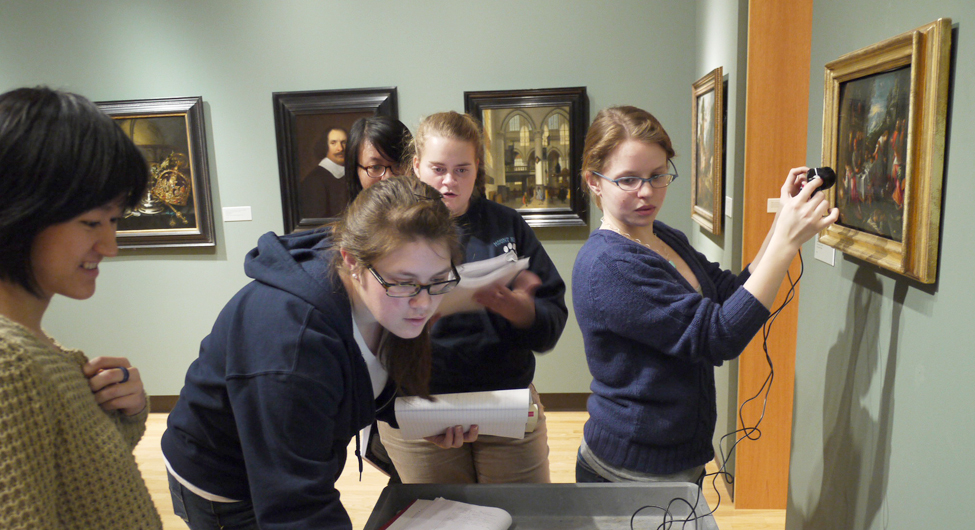 Chemistry students using infrared technology to look beneath a painting's surface