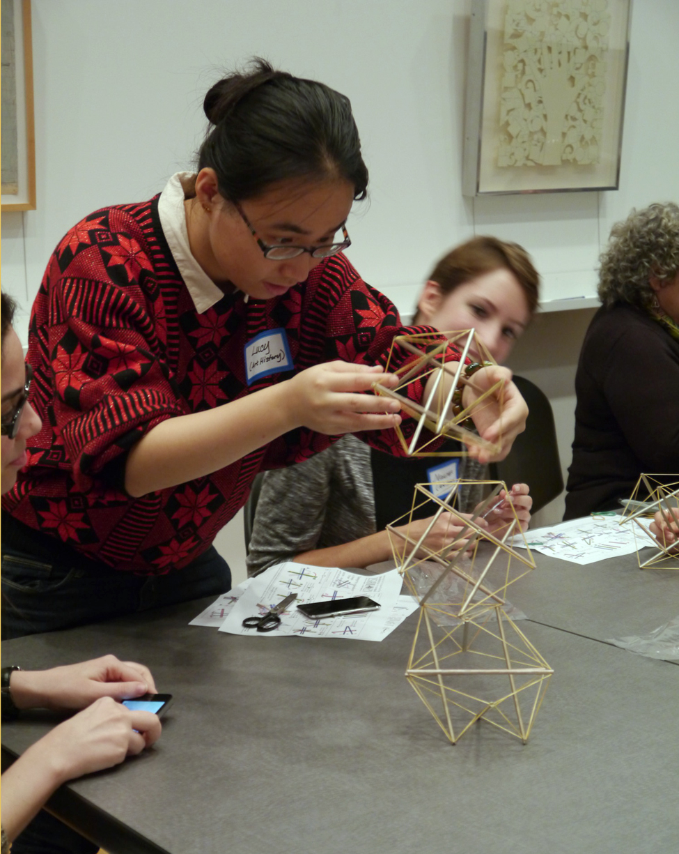 Art and science student partners construct tensegrity models as part of a creativity exercise