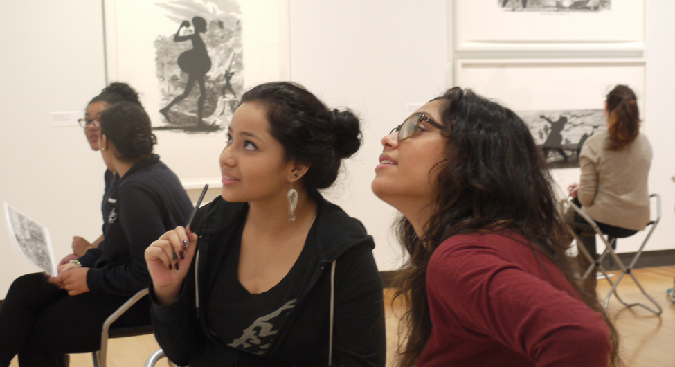 Students in the special exhibition gallery discuss Kara Walker prints