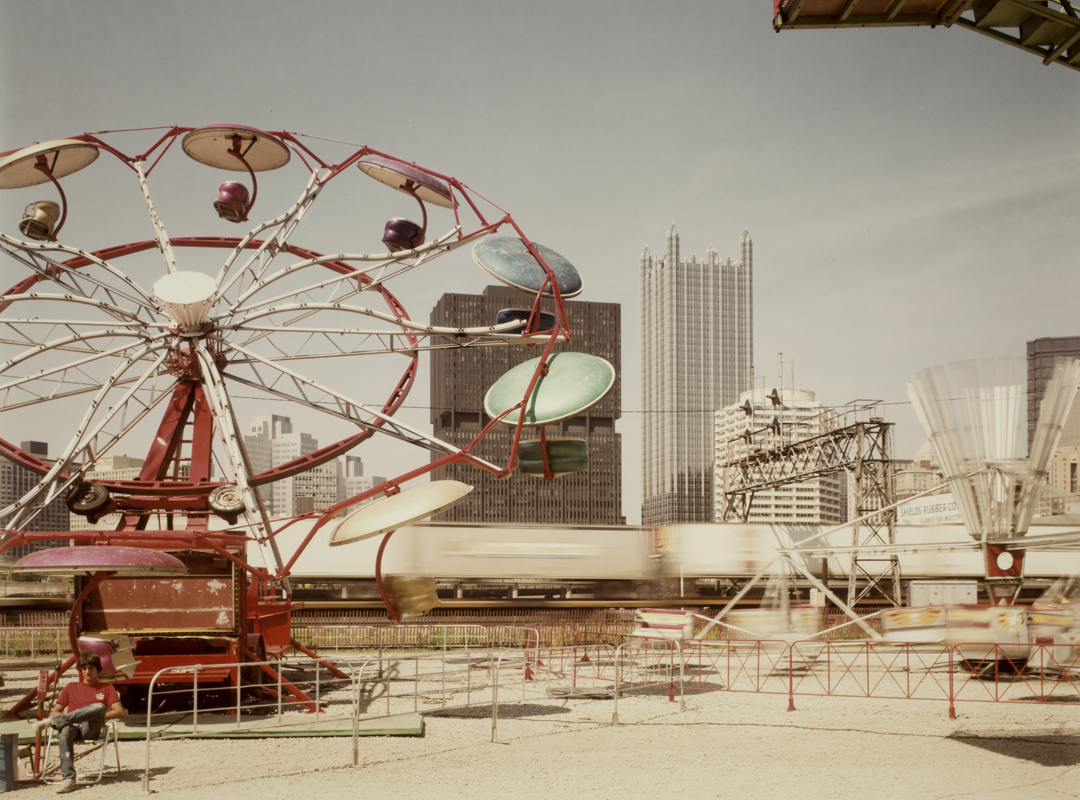 Joel Meyerowitz (American, b. 1946), Pittsburgh, Carnival and train (detail), 1984