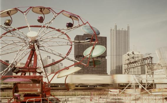 Joel Meyerowitz (American, b. 1946), Pittsburgh, Carnival and train (detail), 1984