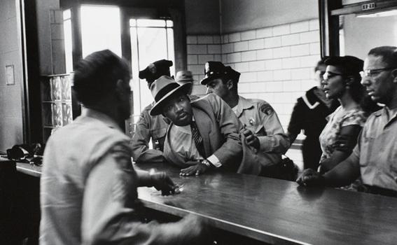 Charles Moore (American, 1931-2010), 	Dr. Martin Luther King, Jr. is arrested for loitering outside a courtroom where his friend and associate Ralph Abernathy is appearing for a trial, from Pictures That Made a Difference: The Civil Rights Movement, 1958