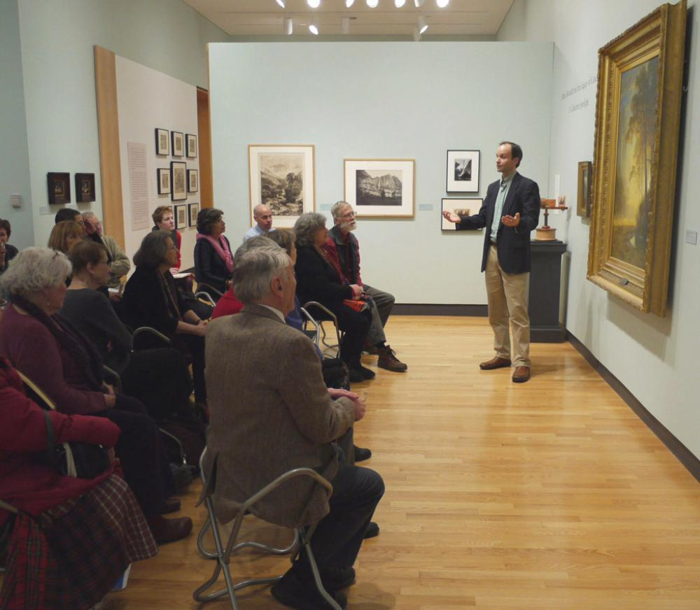 Leslie and Sarah Miller Director of the Miller Worley Center for the Environment Tim Farnham addresses the audience during a gallery talk