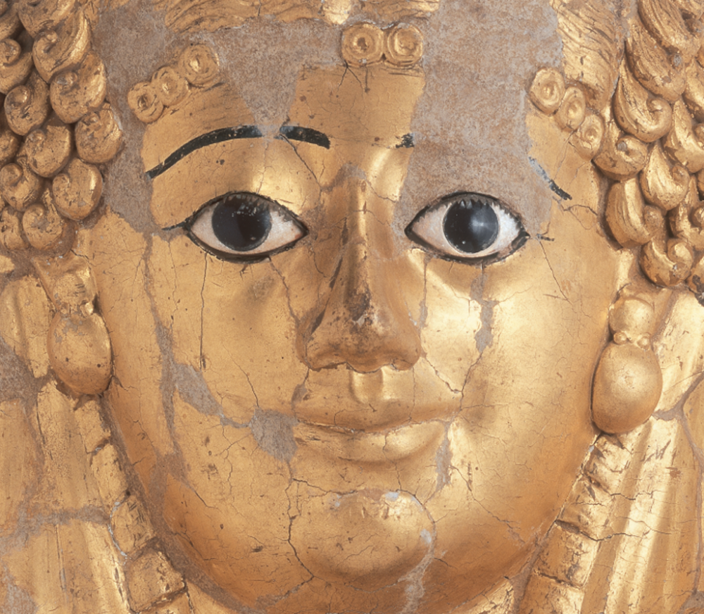 Early Roman Period, Hawara, Mummy mask (detail), cartonnage, gilt, bronze, and glass, 40–60 CE