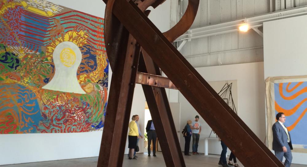 Director's Circle Art Tour participants at the studio of sculptor Mark di Surero