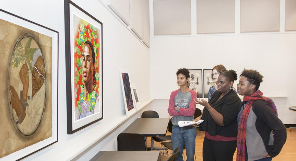 Students in Professor Kimberly Brown's course, Black Women Writers, discuss portraits by contemporary artists Frohawk Two Feathers and Kehinde Wiley