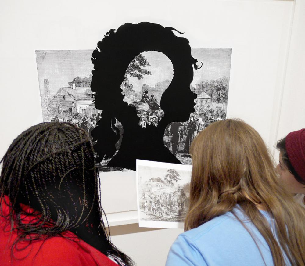 Mary Renda's class discusses a Kara Walker print, fall 2012