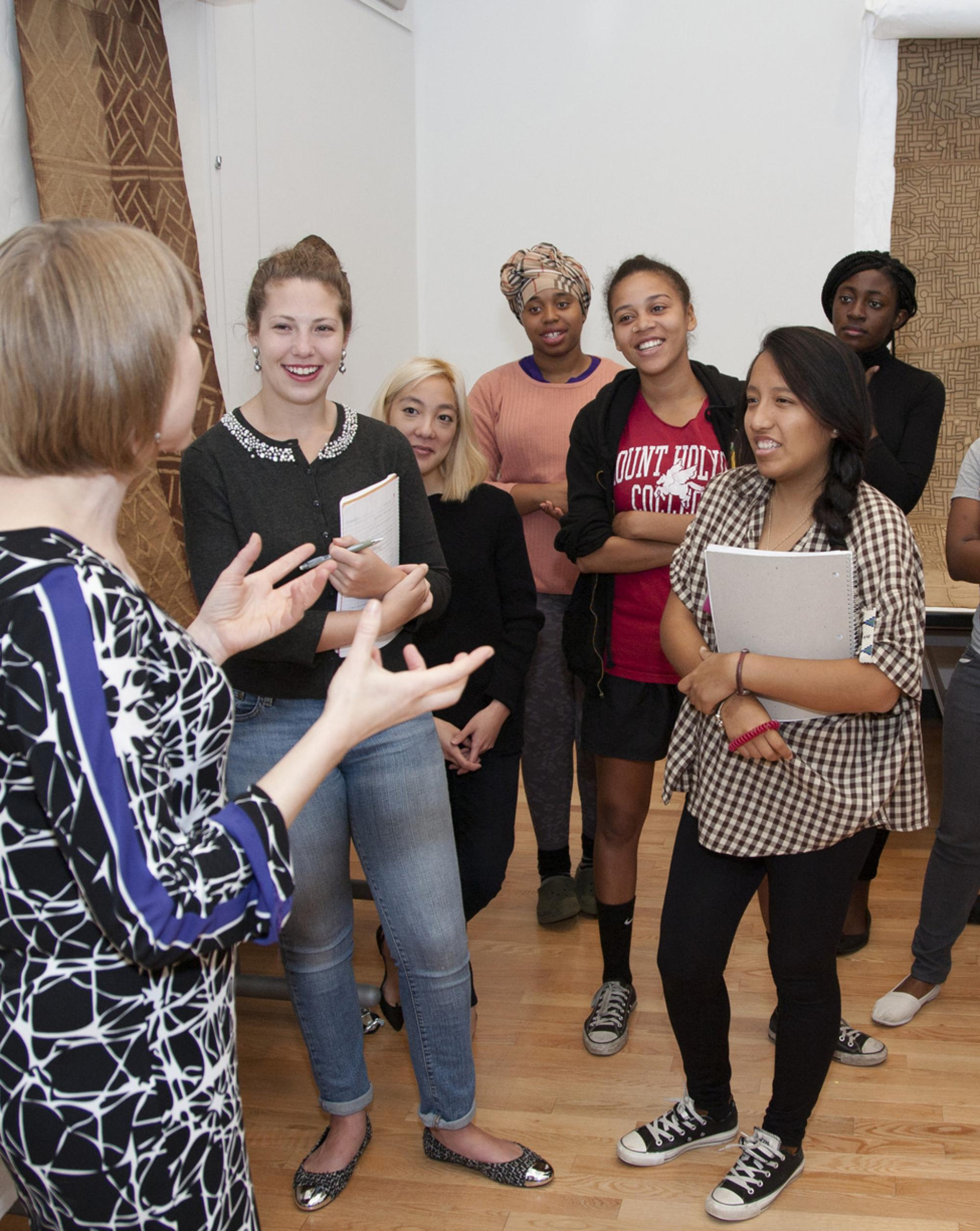Professor Amanda Gilvin and Art History students examine African Art