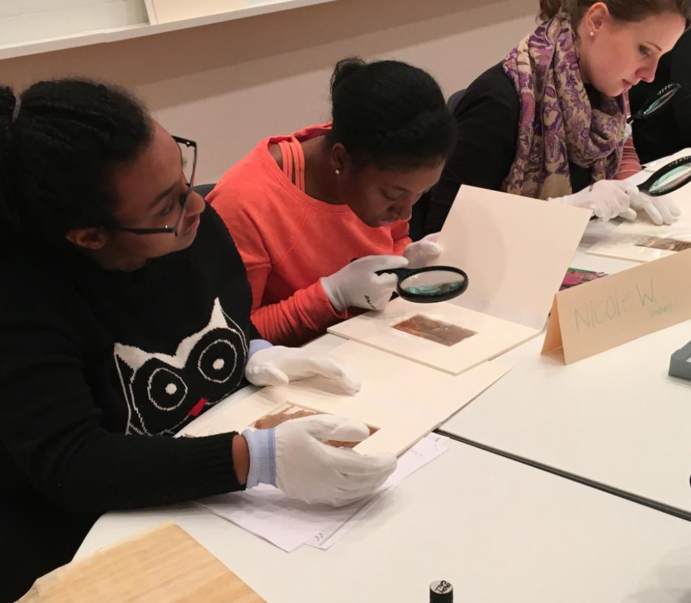 Students examine early coinage and manuscripts