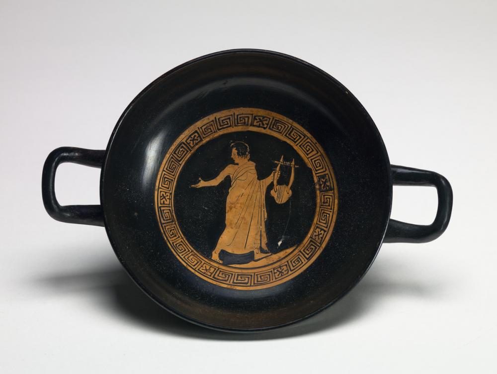 Greek, kylix showing a youth with lyre