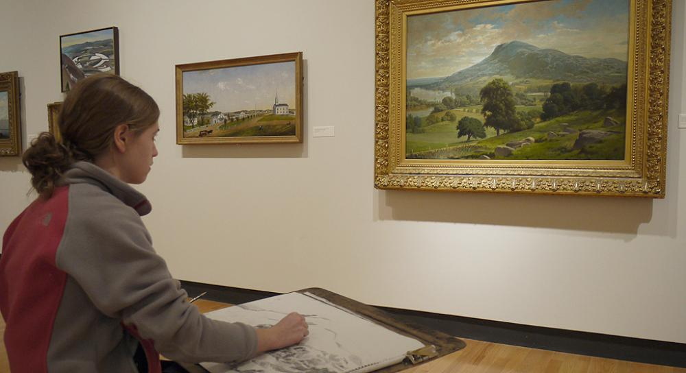 Student sketching in the galleries