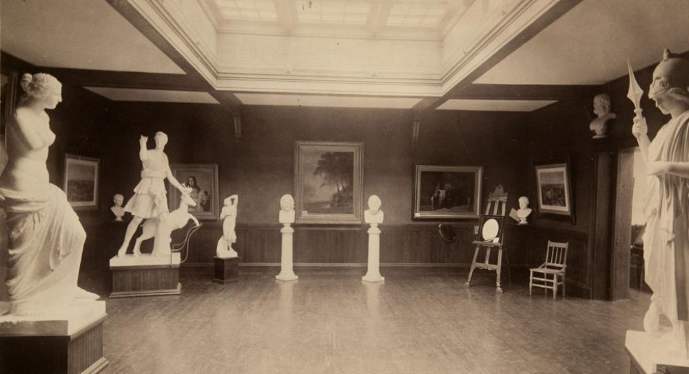 Upper gallery at Dwight Hall; Albert Bierstadt's Hetch Hetchy Canyon displayed on back wall