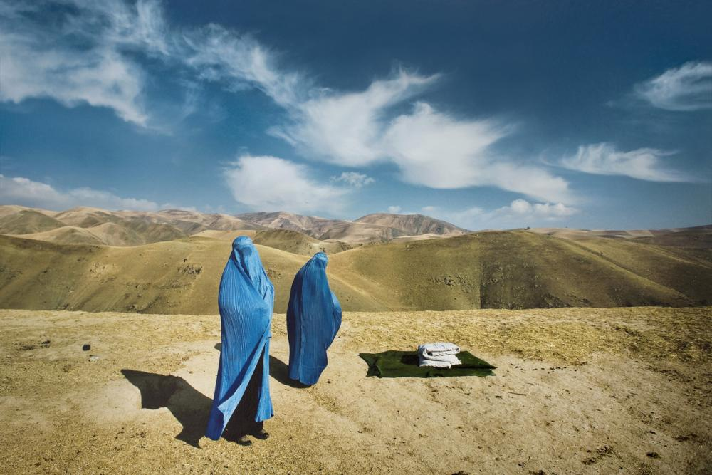 Lynsey Addario (American, b. 1973), Two Burqas: November 14, 2009. Nazer Begam and her pregnant daughter, Noor Nisa, 20, wait for transport to hospital after their car broke down in Badakshan, Afghanistan (#1 from the series Veiled Rebellion), 2009/2015