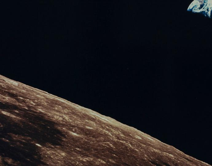 National Aeronautics and Space Administration (American), [Image of the earth taken from the moon with section of the moon and earth visible], 1969 July